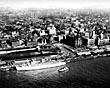 Liverpool City Centre from the air with an Empress boat at the Landing Stage, 1960