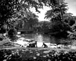 Boys playing by the lake, Birkenhead Park, 1950